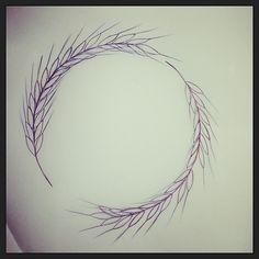 Ce tatouage d'une couronne de deux épis de blé
