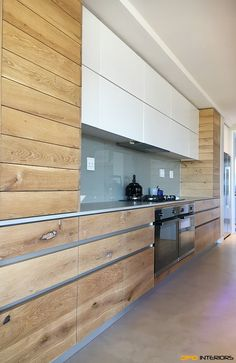 Solid French oak with continuous grain and coated with 5% white Rubio monocote. Blum Legra box doors and drawers, soft close with touch control.