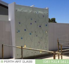 A stunning Slumped Glass feature overlooking a swimming pool.  This custom Textured glass is toughened to meet Australian Safety Standards with Spot lamination of Dichroic Coated glass to give a touch of colour and brilliance. The Dichroic shapes add a beautiful reflective quality which constantly change in variable light conditions and are equally as stunning both Day and night. Slumped Glass, Kiln Formed Glass, Glass Texture, Perth, Glass Art, Swimming Pools, Safety, Touch, Change