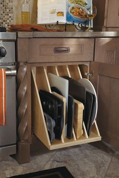 Our Tray Divider Pull Out includes four sections that are perfect for storing all of your oversized items, such as cookie sheets or baking pans.