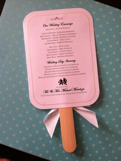 Great for an outdoor wedding! Have the itinerary built to a stick to create a fan.