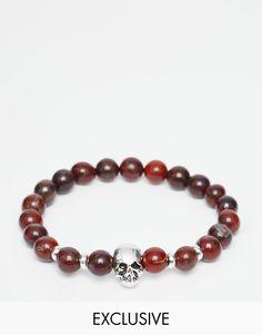 Armband von Reclaimed Vintage silberfarbene Optik Perlenkette Totenkopfanhänger elastisches Design zum Reinschlüpfen 100% Kunststoff Produkte sind aufgrund ihrer besonderen Beschaffenheit nicht identisch exklusiv bei ASOS