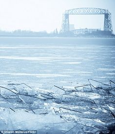 Video shows waves of frozen Lake Superior breaking up on the shore like glass | Daily Mail Online