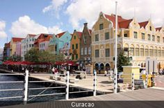 Willemstad Curacao, Netherlands Antilies. I walked across this bridge on a trip with my parents and younger brother, when I was 14. Even at that age, the colors of the buildings were breathtaking!