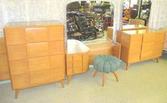 Mid century Modern Heywood Wakefield Kohinoor Bedroom Suite in Champagne Exceptional Original Condition Full Bed, Highboy, Mirrored Dresser, Mirrored Vanity with Tuffet Stool... Mid Century Modern at its best !  Stamped Nov 9, 1949 Authentic, ORIGINAL & Complete - Full Size with Headboard, Footboard, & Rails - Large 3 drawer dresser with TILT Mirror -Highboy / Chest with 4 drawers -Mirrored Vanity with Tambour Door -Tuffet Vanity Stool  These pieces are from a great High end, Mid...