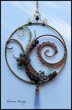 Gemstone and Crystal Swirl Suncatcher, Window Decoration with Australian Pewter Lizard. $52.00, via Etsy.  - she has some amazing stuff on her site!!