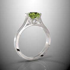 A personal favorite from my Etsy shop https://www.etsy.com/listing/191544550/10k-white-gold-engagement-ring-7mm-round