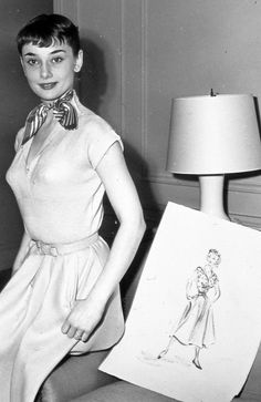 """rareaudreyhepburn: """"Audrey Hepburn posed next to a sketch by Edith Head during the production of Roman Holiday, c. 1952. """""""