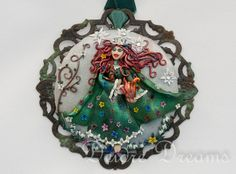 Custom Order, #jewelry, #polymerclay, #goddesbrigid, #celticgoddes, #artjewelry, #pagangoddes, #wiccangoddess, #pendant, #polymerclaypendant, #paganart, #wiccanart, #wearableart, #goddessofspring, #goddessoffire The Celtic Goddess Brigid, Goddess of Spring and Fire, depicted holding a March Hare and a fire ball, her touch makes flowers sprout from the ground.