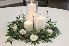 Greenery and spray rose centerpiece with pillar candles // white and greenery wedding inspiration // Celebration Flair Greenery Centerpiece, Floating Candle Centerpieces, Candle Wedding Centerpieces, Flower Centerpieces, Pillar Candles, Centerpiece Ideas, Eucalyptus Centerpiece, September Wedding Centerpieces, Hurricane Centerpiece