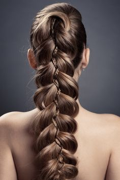 Modern structural braid. Sprinkle Big Sexy Hair Powder play on braided strands and pull them apart to get big braided strands like this. https://www.sexyhair.com/p/big-sexy-hair/powder-play #PowderPlay #SexyHair #Braids