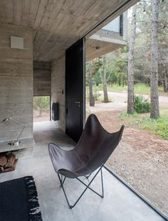 Concrete holiday home by Luciano Kruk has glass walls