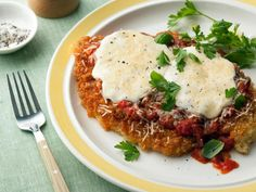 Chicken Parmigiana: Bobby tops seared breaded chicken breasts with a simple tomato sauce, then continues cooking them in the oven. #RecipeOfTheDay