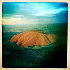 Uluru  My Comment I have flown over this and the nearby Olgas. Amazing.