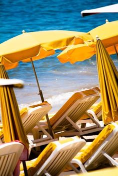 I want to go to a warm beach and sit under a yellow umbrella.
