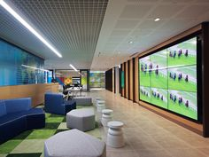 PTID has designed the new offices of gambling and gaming company Tabcorp located in Sydney, Australia. Tabcorp's relocation to a CBD site provided an Modular Lounges, Modular Sofa, Office Interior Design, Office Interiors, Office Designs, Tech Room, Blue Office, Waiting Area, Video Wall