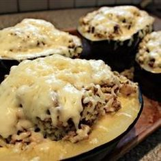 Acorn squash is partially cooked in the microwave, then filled with turkey sausage, broccoli, cheese, rice, and apples.