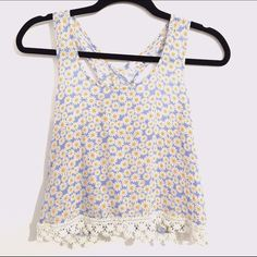 ☀️Light blue floral crop top with lace detailing☀️ Flowy blue crop top with daisy printed fabric. Has lace detailing on the bottom and a criss cross back. This is a perfect item for the hot summer months & because it has a criss cross back it would look great with a bikini underneath. The size is a S and it was made by the brand Mine.  ✖️No PayPal or trades ✔️Reasonable offers will be accepted ✔️Items will be shipped between 1-2 business days  Bundle 2+ items to get 10% off! Mine Tops Crop…