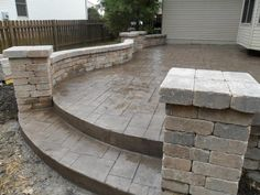 Like this color of concrete and the stamp pattern with the paver retaining wall.