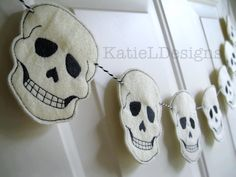 ITH Skull Feltie Machine Embroidery Design by KatieLDesigns. Fun Halloween decor idea! These were strung together with bakers twine and hung on the front door.