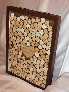 Personalized wooden heart drop box guest book 80, 150, 200 or 250 Hearts to sign.  Guests sign a heart and then drop through one of the post here
