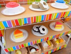 Cardboard cake shop.  There is also a lovely cafe on the same blog with lots of tips for working with cardboard.