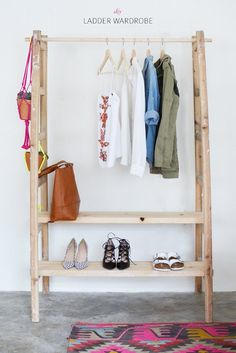 What a creative and cute idea, perfect for a small apartment or photography studio DIY LADDER WARDROBE