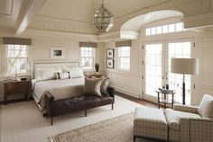East Coast House with Blue and White Coastal Interiors: This neutral bedroom offers timeless milwork and a very soothing color scheme.