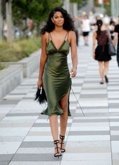 Chanel Iman in New York City - August 18, 2015 Tip: The slip dress is most definitely back. No '90s girl would be without her slinky slip dress � Just ask Carolyn Bessette-Kennedy, who famously wore a gown by the king of the bias-cut, Narciso Rodriguez, on her wedding day. Here, model Chanel Iman shows us the look's still got legs in her Alexander Wang dress, accessorized perfectly low-key with strappy heels and unfussy hair. Shop the look: Alexander Wang Satin Midi Dress, $1,295…