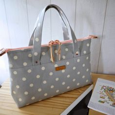 HandCarry Bag : Simple Dots . SOLD     M a t e r i a l s :   + Canvas, Cotton Linen   + Cow leather accessories   + YKK Gia...