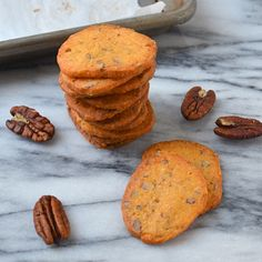pecan cheddar crackers/ 2 sticks unsalted butter 1 pound sharp cheddar cheese, grated 1 large egg yolk 3 tablespoons dijon mustard 2 tablespoons dry mustard 1/4 cup yellow mustard seeds 2 teaspoons salt 1/2 teaspoon cayenne pepper 2 cups all purpose flour 1/2 cup finely chopped pecans special equipment: 7 cup or greater food processor