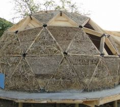 Geodesic structure with straw bale infill
