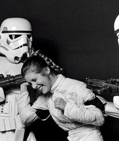 Carrie Fisher having fun with two Stormtrooper extras.