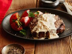 Rib Eye Steak with Onion Blue Cheese Sauce from FoodNetwork.com