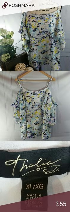 NWT, Thalia Sodi Cold Shoulder, Flutter Sleeve Top From the striking off-the-shoulder silhouette to the layered flutter sleeves, Thalia Sodi's graceful daytime top is a refreshing and playful pick. Fun and flirty multi color print top with a scoop neckline, cold-shoulder cutouts, layered flutter sleeves; adjustable straps, Made from polyester/spandex; lining: polyester. Machine washable. No damage or flaws. Size conversion according to the Thalia Sodi Size Chart: size XL =16-18, Bust 42.5…