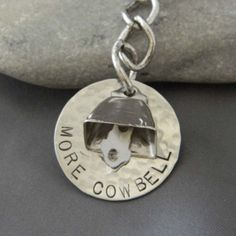 More cowbell keychain, would be cute for a necklace or bracelet