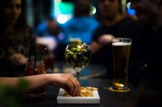 #alcohol #bar #beer #beverage #blur #drink #drinks #focus #glass #juice #macro #olives #peanuts #restaurant #table #wine glass