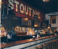 Stout - 133 W. 33rd St. (nr. 7th Ave.) Dubliners Martin and Mark Whelan spent years perfecting their brand before opening this Superdome of taverns. The 16,000-square-foot, tri-level megaspace with its 36 large-screen TVs goes beyond mere spectator sportsmanship with a subterranean cellar level with billiard rooms and 4 dartboards. D.J. sets, live Celtic bands, and karaoke are also weekly occurrences, but most customers belly up to the 60-foot bar to sample one of 200-plus beers.