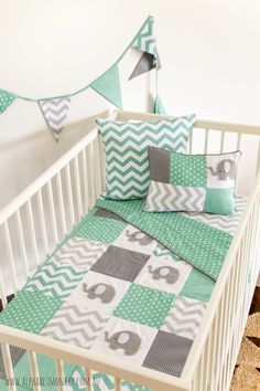 The elephant quilt is one of our most popular designs and features our hand stitched felt elephants. Our new range features a beautiful mint green and grey combination. Perfect to add either pin…