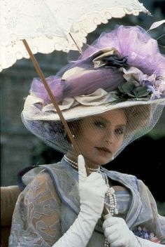 The lovely Italian actress Ornella Muti wearing a gorgeous Edwardian outfit accessorized with white kid opera gloves for her role in the 1983 film Swann In Love