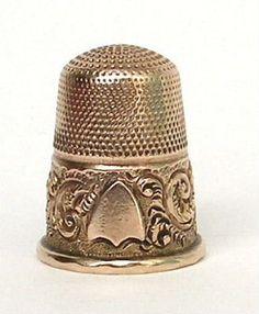 Antique thimbles, silver thimbles, gold thimbles.