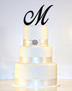 Custom  5 inch Monogram Acrylic Wedding Cake Topper by ShopTheTop, $15.00. Also comes in gold mirror.