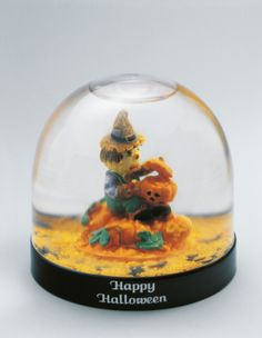 Close-up of a figurine of a witch in a snow globe