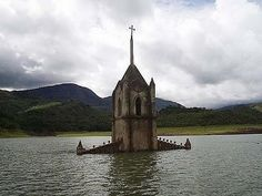 A town church once nearly submerged by the damming of a river is now hauntingly visible as the water recedes