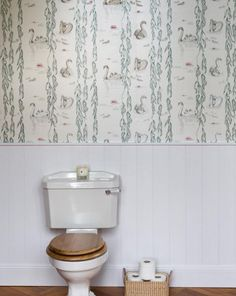 Great to see our new Regal wallpaper installed in a clients bathroom. Panelling is a brilliant way of breaking up your wall space to allow a wallpaper to create an impact on just the upper section rather than the whole wall. It's also a good way of keeping it out of arms reach of little people to draw on to as well!  #swans #wallpaper #birds #illustration #drawing #design #details #regal #albion #british #inspiration #interiors #home #bathroom #luxury #lifestyle #interiordesign