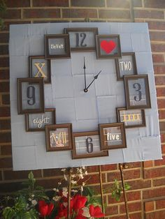 DIY clock with picture frames CUTE! but I'm not so fond of the blue background....I think it would be cutest on just a plain wall!