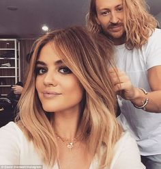 '#BTS with this hottie!' The Let It Go songstress' outdated ombré locks were coiffed by David Stanwell and her make-up was applied by Allan Avendaño