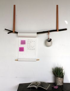 Use an old tree branch and a vintage belt to make this minimalist display for notes and pens. | 54 Ways To Make Your Cubicle Suck Less