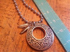 Bohemian feather charm silver necklace on Etsy, $14.95