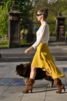 Hi low skirt outfit idea #1.   Wear a hi low skirt with a loose shirt and heeled boots.
